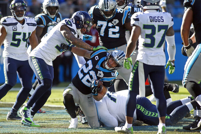 Seattle Seahawks strong safety Bradley McDougald (30) can't stop Carolina Panthers running back Christian McCaffrey (22) from scoring a touchdown during the first half of an NFL football game in Charlotte, N.C., Sunday, Dec. 15, 2019. (AP Photo/Brian Blanco)