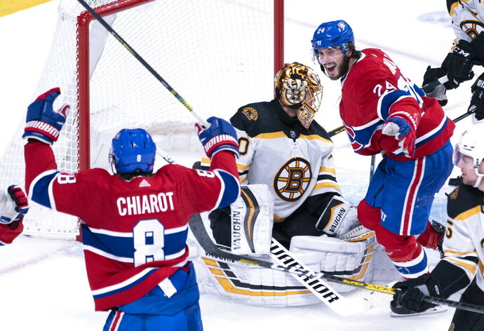 Montreal Canadiens' Phillip Danault, right, celebrates a goal by teammate Ben Chiarot, not shown, past Boston Bruins goaltender Tuukka Rask during the third period of an NHL hockey game Tuesday, Nov. 5, 2019, in Montreal. (Paul Chiasson/The Canadian Press via AP)
