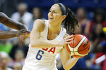 FILE - United States' Sue Bird, right, is defended during the first half of a women's exhibition basketball game against Canada  in Bridgeport, Conn., in this Friday, July 29, 2016, file photo. Sue Bird and Diana Taurasi will try and become the first five-time Olympic gold medalists in basketball as they lead the U.S women's team at the Tokyo Games. The duo was selected for their fifth Olympics on Monday, June 21, 2021, joining Teresa Edwards as the only basketball players in U.S. history to play in five.(AP Photo/Jessica Hill, FIle)