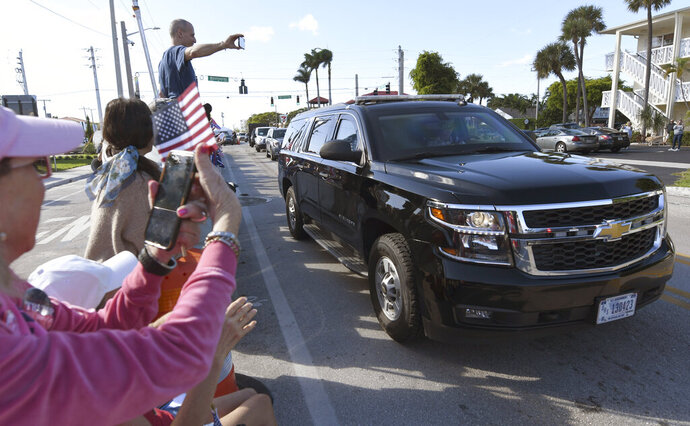 President Donald Trump's motorcade returns from the Trump International Golf Club located in West Palm Beach, to Mar-a-Lago, Sunday, Jan. 5, 2020 (AP Photo/Jim Rassol)