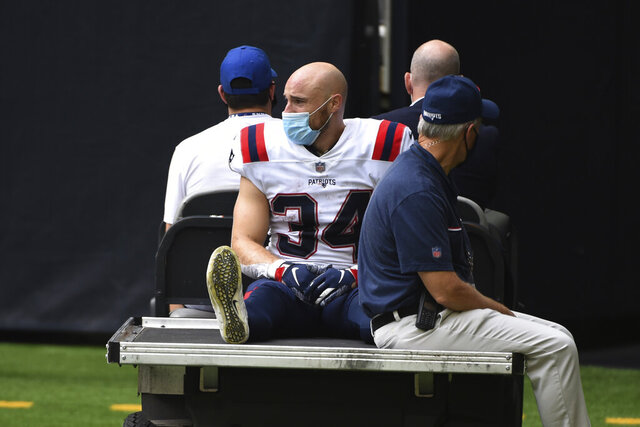 New England Patriots running back Rex Burkhead (34) is taken off the field by cart after an injury during the second half of an NFL football game against the Houston Texans, Sunday, Nov. 22, 2020, in Houston. (AP Photo/Eric Christian Smith)