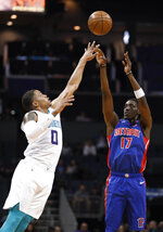 Detroit Pistons' Tony Snell (17) shoots over Charlotte Hornets' Miles Bridges (0) during the second half of an NBA preseason basketball game in Charlotte, N.C., Wednesday, Oct. 16, 2019. The Pistons won 116-110. (AP Photo/Bob Leverone)