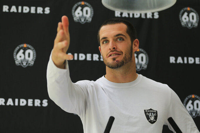 Oakland Raiders' quarterback Derek Carr attends a press conference after a practice session at the Grove Hotel in Chandler's Cross, Watford, England, Wednesday, Oct. 2, 2019. The Oakland Raiders are preparing for an NFL regular season game against the Chicago Bears in London on Sunday. (AP Photo/Leila Coker)