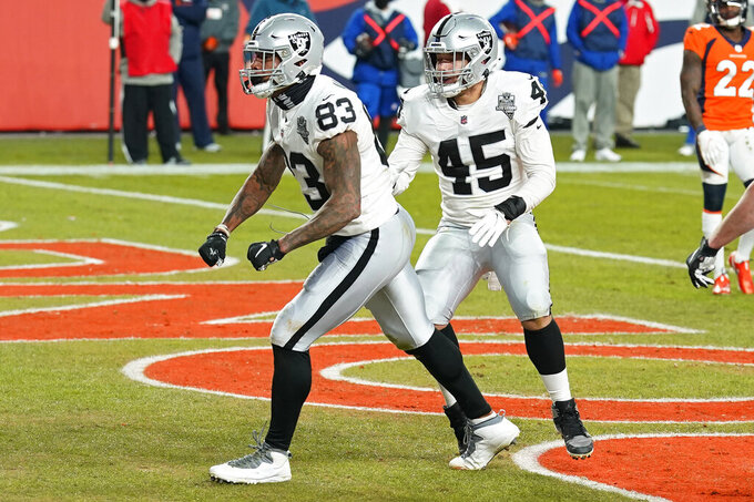 Las Vegas Raiders tight end Darren Waller (83) celebrates after making a catch for a 2-point conversion against the Denver Broncos during the second half of an NFL football game, Sunday, Jan. 3, 2021, in Denver. (AP Photo/David Zalubowski)