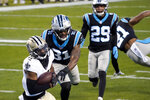 New Orleans Saints wide receiver Emmanuel Sanders scores past Carolina Panthers strong safety Juston Burris during the first half of an NFL football game Sunday, Jan. 3, 2021, in Charlotte, N.C. (AP Photo/Gerry Broome)