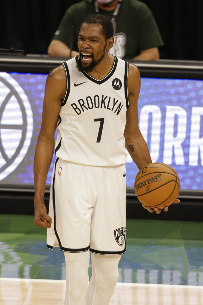 Brooklyn Nets' Kevin Durant yells during the second half of Game 6 of a second-round NBA basketball playoff series against the Milwaukee Bucks, Thursday, June 17, 2021, in Milwaukee. (AP Photo/Jeffrey Phelps)