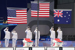 The flags are raised for the medal ceremony for the men's 400 meter individual medley at the 2020 Summer Olympics, Sunday, July 25, 2021, in Tokyo, Japan. (AP Photo/Martin Meissner)