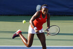 Cori Gauff returns the ball as she and Caty McNally played against Fanny Stollar, of Hungary, and Maria Sanchez in the women's doubles final at the Citi Open tennis tournament Saturday, Aug. 3, 2019, in Washington. (AP Photo/Patrick Semansky)