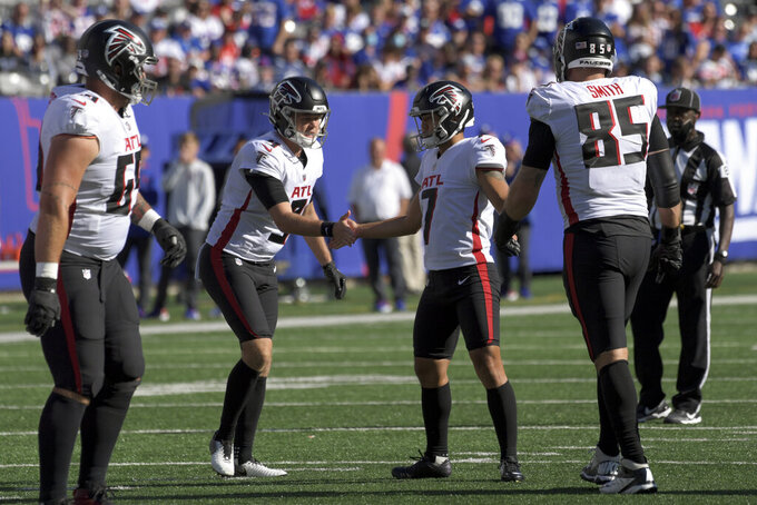 Atlanta Falcons kicker Younghoe Koo (7) celebrates with placeholder Cameron Nizialek (9) after kicking the extra point to tie the game during the second half of an NFL football game against the New York Giants, Sunday, Sept. 26, 2021, in East Rutherford, N.J. (AP Photo/Bill Kostroun)