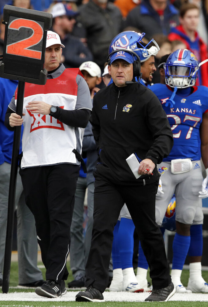 Kansas head coach David Beaty works the side lines during the first half of an NCAA college football game against Texas in Lawrence, Kan., Friday, Nov. 23, 2018. (AP Photo/Orlin Wagner)