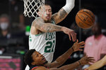 Boston Celtics' Daniel Theis (27) blocks a shot by Toronto Raptors' Kyle Lowry during the first half of an NBA conference semifinal playoff basketball game Saturday, Sept. 5, 2020, in Lake Buena Vista, Fla. (AP Photo/Mark J. Terrill)