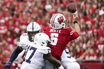 Penn State's Arnold Ebiketie hits Wisconsin's Graham Mertz as he throws during the first half of an NCAA college football game Saturday, Sept. 4, 2021, in Madison, Wis. (AP Photo/Morry Gash)