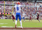 Florida wide receiver Trevon Grimes (8) makes a wide open touchdown catch from Florida quarterback Feleipe Franks (13) in the second half of an NCAA college football game against Florida State in Tallahassee, Fla., Saturday, Nov. 24, 2018. Florida defeated Florida State 41-14. (AP Photo/Mark Wallheiser)