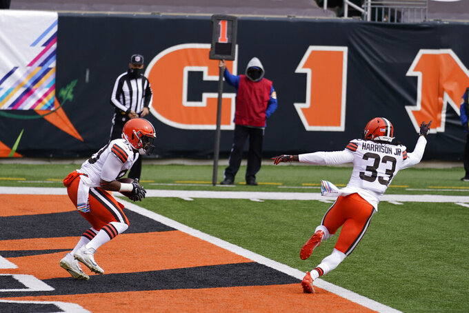 Cleveland Browns' B.J. Goodson, left, intercepts a pass in the end zone during the first half of an NFL football game against the Cincinnati Bengals, Sunday, Oct. 25, 2020, in Cincinnati. (AP Photo/Michael Conroy)