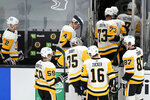 Pittsburgh Penguins goaltender Tristan Jarry (35) follows teammates off the ice after giving up the game winning during the overtime period of an NHL hockey game, Tuesday, Jan. 26, 2021, in Boston. The Bruins won 3-2. (AP Photo/Charles Krupa)