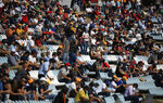 Fans wait in the stands to watch qualification for the Formula One Portuguese Grand Prix at the Algarve International Circuit in Portimao, Portugal, Saturday, Oct. 24, 2020. The Formula One Portuguese Grand Prix will take place on Sunday. (Jorge Guerrero, Pool via AP)