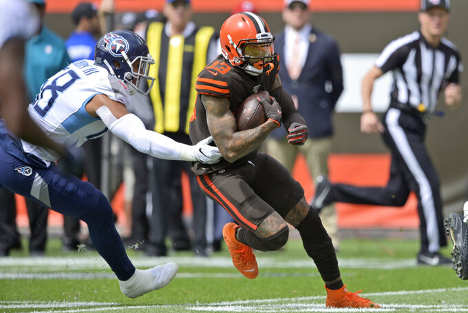 Cleveland Browns wide receiver Odell Beckham Jr., right, rushes during the first half in an NFL football game against the Tennessee Titans, Sunday, Sept. 8, 2019, in Cleveland. (AP Photo/David Richard)