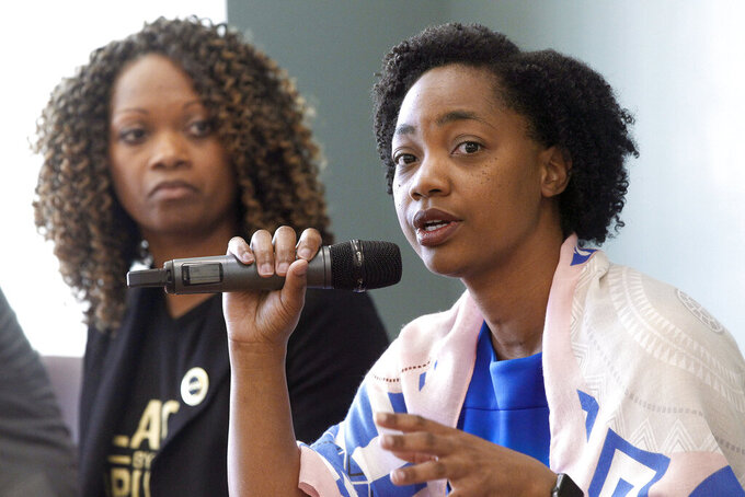 FILE - In this Feb. 23, 2019 file photo La Mesa City Council member Akilah Weber speaks as she sits with other members of the panel during the Black Excellence in Public Service: Serving and Protecting Our Children forum held at the Skyline Hills Branch Library in San Diego. Weber, the daughter of California's top elections official has succeeded her mother in the state Legislature. That adds to a long tradition of frequent family connections among lawmakers. Weber won the San Diego area's 79th Assembly District seat with more than half the vote. She's an OB-GYN with Rady Children's Hospital and UC San Diego Health. (Hayne Palmour IV/The San Diego Union-Tribune via AP, File)