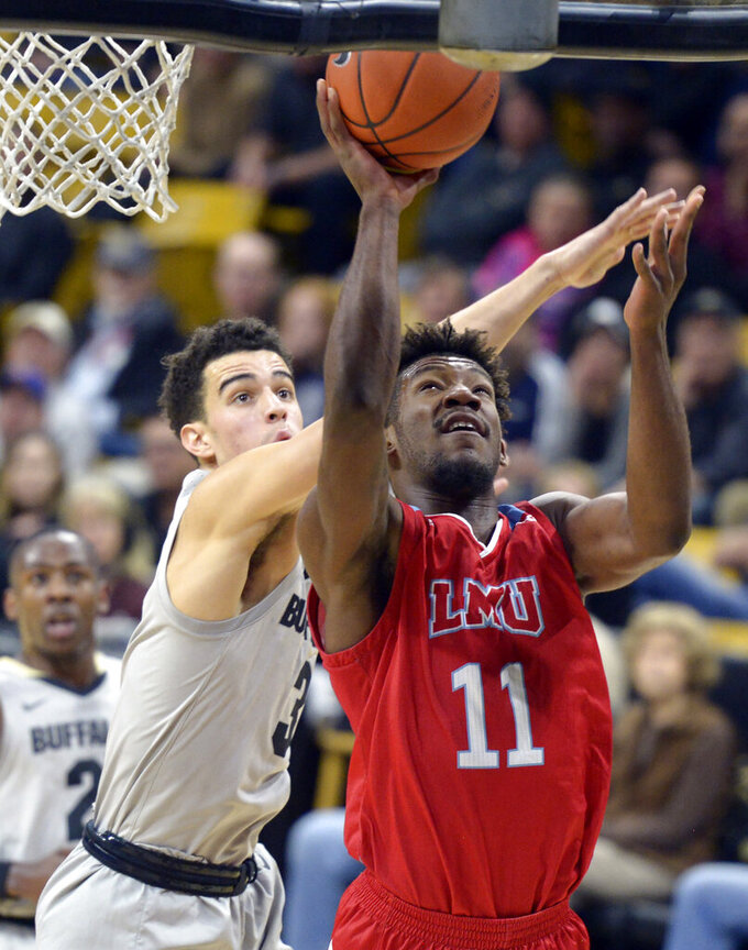 Loyola Marymount forward Parker Dortch, front, drives to the basket past Colorado forward Maddox Daniels during the first half of an NCAA college basketball game Wednesday, Dec. 4, 2019, in Boulder, Colo. (AP Photo/Cliff Grassmick)