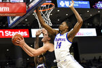 DePaul center Nick Ongenda (14) defends Northwestern forward Miller Kopp (10) during the first half of an NCAA college basketball game, Saturday, Dec. 21, 2019, in Chicago. (AP Photo/David Banks)