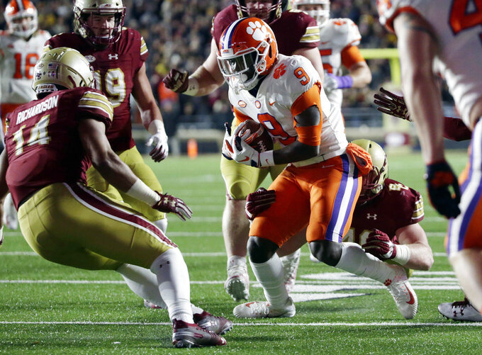 Boston College linebacker Max Richardson (14) pursues Clemson running back Travis Etienne (9) during the first half of an NCAA college football game Saturday, Nov. 10, 2018, in Boston. (AP Photo/Elise Amendola)