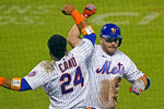New York Mets Robinson Cano (24) celebrates with Pete Alonso after Alonso hit a solo home run during the eighth inning of the team's baseball game against the Baltimore Orioles, Wednesday, Sept. 9, 2020, in New York. The Met defeated the Orioles 7-6. (AP Photo/Kathy Willens)