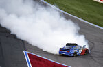 Ricky Stenhouse Jr. (17) spins down the front stretch during a NASCAR Cup Series auto race at Charlotte Motor Speedway in Concord, N.C., Sunday, May 26, 2019. (AP Photo/Mike McCarn)