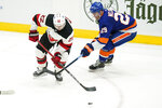 New York Islanders' Brock Nelson (29) fights for control of the puck with New Jersey Devils' Ryan Murray (22) during the second period of an NHL hockey game Saturday, May 8, 2021, in Uniondale, N.Y. (AP Photo/Frank Franklin II)