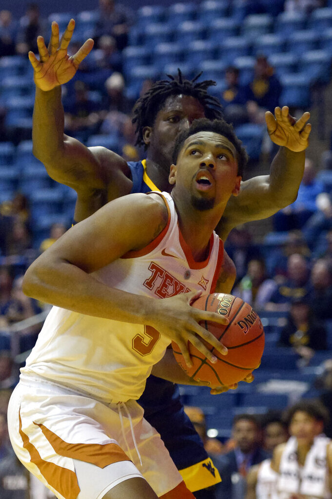 Texas forward Royce Hamm Jr. (5) looks for an opening during the second half of an NCAA college basketball game against West Virginia in Morgantown, W.Va., Saturday, Feb. 9, 2019. (AP Photo/Craig Hudson)