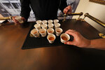 A person takes a sample of rye whiskey during a media preview for the Sazerac house, in New Orleans, Tuesday, Sept. 10, 2019. Visitors to New Orleans who want to learn more about cocktails will soon have a new place to go. No, it's not another bar. The Sazerac House is a six-story building on the city's famed Canal Street owned by the Sazerac Company, a Louisiana-based spirits maker, featuring the signature New Orleans drink called the Sazerac. Tasting is encouraged, and in addition to free samples given to visitors, there will also be special classes and tastings offered daily. (AP Photo/Gerald Herbert)