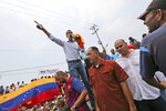 Juan Guaidó, opposition leader and self-proclaimed interim president of Venezuela, speaks to supporters during a rally on the shore of Lake Maracaibo in Cabimas, Venezuela, Sunday, April 14, 2019.