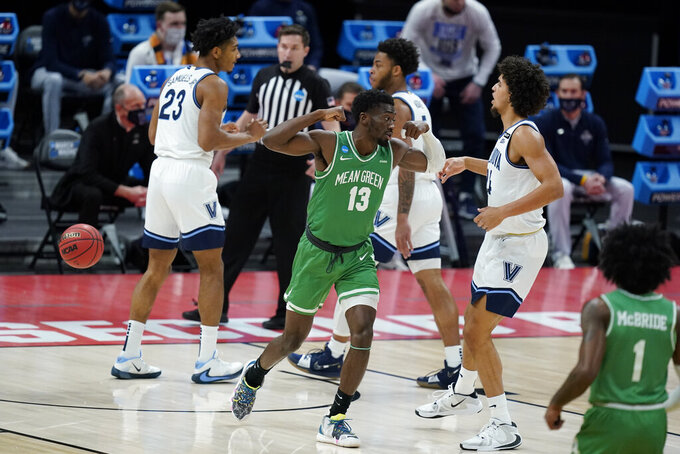 North Texas's Thomas Bell (13) reacts after scoring during the first half of a second-round game against Villanova in the NCAA men's college basketball tournament at Bankers Life Fieldhouse, Sunday, March 21, 2021, in Indianapolis. (AP Photo/Darron Cummings)