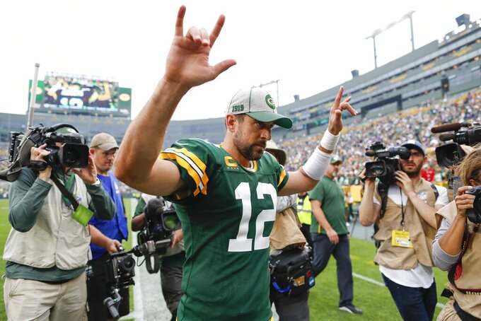 Green Bay Packers' Aaron Rodgers celebrates after an NFL football game against the Minnesota Vikings Sunday, Sept. 15, 2019, in Green Bay, Wis. The Packers won 21-16. (AP Photo/Matt Ludtke)