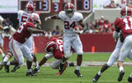 Alabama running back Brian Robinson Jr. (24) breaks into the open as Alabama linebacker Shane Lee (35) pursues during the first half of Alabama's A-Day NCAA college football scrimmage, Saturday, April 13, 2019, in Tuscaloosa, Ala. (AP Photo/Vasha Hunt)
