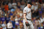 San Francisco Giants relief pitcher Will Smith reacts after giving up a two-run home run to Colorado Rockies' Ian Desmond during the ninth inning of a baseball game Tuesday, July 16, 2019, in Denver. (AP Photo/David Zalubowski)