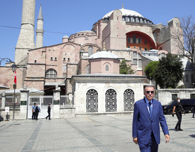 FILE - In this Aug. 7, 2020 file photo, Turkey's President Recep Tayyip Erdogan arrives to speak to supporters and the media after Friday prayers in Hagia Sophia, in the background, in Istanbul. Egypt's Parliament on Tuesday, Aug. 18,  approved a maritime deal setting the country's Mediterranean Sea boundary with Greece and demarcating an exclusive economic zone for oil and gas drilling rights, the state-run news agency reported. The deal, which was signed earlier this month, angered Turkey, which vowed to resume its disputed oil and gas exploration in the eastern Mediterranean Sea.    (Turkish Presidency via AP, Pool)