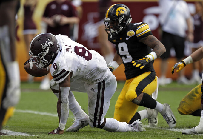 Mississippi State running back Kylin Hill (8) scores in front of Iowa defensive back Geno Stone during the second half of the Outback Bowl NCAA college football game Tuesday, Jan. 1, 2019, in Tampa, Fla. (AP Photo/Chris O'Meara)