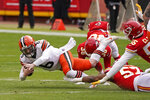 Cleveland Browns quarterback Baker Mayfield (6) dives for extra yardage ahead of Kansas City Chiefs defensive end Frank Clark, right, during the first half of an NFL divisional round football game, Sunday, Jan. 17, 2021, in Kansas City. (AP Photo/Charlie Riedel)