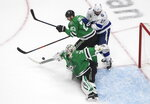 Dallas Stars goaltender Anton Khudobin (35) turns the puck away as Tampa Bay Lightning center Alex Killorn (17) and Stars defenseman Esa Lindell (23) look for the puck during the second period of Game 3 of the NHL hockey Stanley Cup Final, Wednesday, Sept. 23, 2020, in Edmonton, Alberta. (Jason Franson/The Canadian Press via AP)