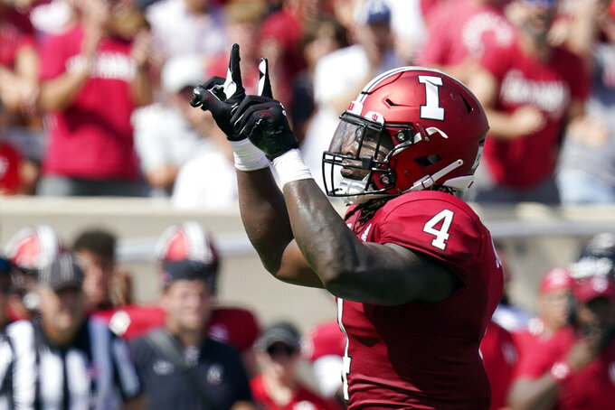 Indiana's Cam Jones (4) reacts during the first half of an NCAA college football game against the Cincinnati, Saturday, Sept. 18, 2021, in Bloomington, Ind. (AP Photo/Darron Cummings)