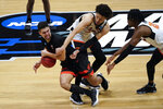 Oregon State guard Jarod Lucas (2) tries to protect the ball from Oklahoma State guard Cade Cunningham (2) during the second half of a men's college basketball game in the second round of the NCAA tournament at Hinkle Fieldhouse in Indianapolis, Monday, March 22, 2021. (AP Photo/Paul Sancya)