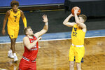 West Virginia guard Sean McNeil (22) shoots the ball over a Western Kentucky defender during the first half of an NCAA college basketball game Friday, Nov. 27, 2020, in SIoux Falls, S.D. (AP Photo/Josh Jurgens)