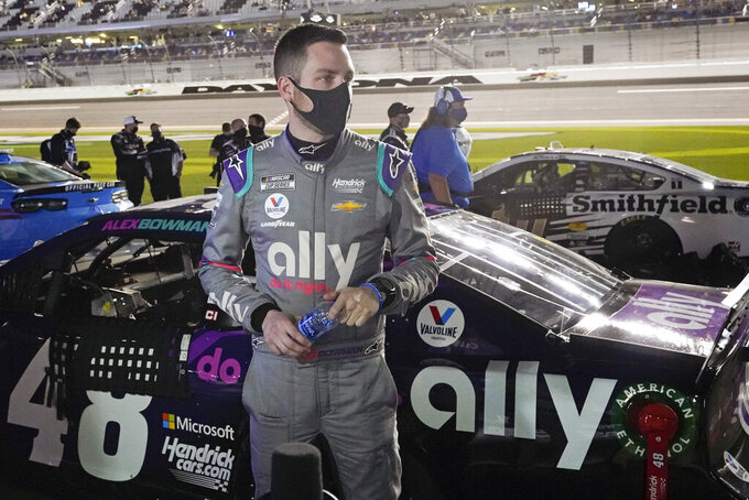 Alex Bowman stands by his car on pit road before the first of two qualifying NASCAR auto races for the Daytona 500 at Daytona International Speedway, Thursday, Feb. 11, 2021, in Daytona Beach, Fla. (AP Photo/John Raoux)