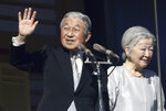 FILE - In this Jan. 2, 2019, file photo, Japan's Emperor Akihito and Empress Michiko greet to well-wishers from the bullet-proofed balcony during his New Year's public appearance with his family members at Imperial Palace in Tokyo. Akihito has devoted his 30-year reign to making amends for a war fought in his father's name, while adapting the 1,500-year-old monarchy to draw the Imperial Family closer to the public. Akihito's Heisei era will end when he abdicates on April 30, 2019 in favor of his elder son, 58-year-old Crown Prince Naruhito, beginning a new, as yet unnamed era. (AP Photo/Eugene Hoshiko, File)
