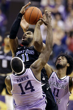 Saint Louis' Hasahn French, top, shoots under pressure from Kansas State's Makol Mawien (14) and Antonio Gordon, right, during the second half of an NCAA college basketball game Saturday, Dec. 21, 2019, in Kansas City, Mo. (AP Photo/Charlie Riedel)