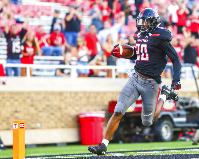 Texas Tech's Adrian Frye (20) returns an interception for a touchdown during an NCAA college football game against Lamar, Saturday, Sept. 8, 2018, in Lubbock, Texas. (John Moore/Lubbock Avalanche-Journal via AP)