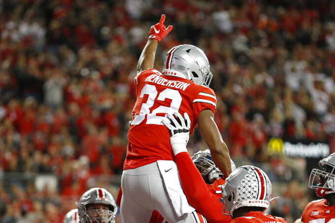 Ohio State running back TreVeyon Henderson, top, celebrates his touchdown against Akron during the first half of an NCAA college football game Saturday, Sept. 25, 2021, in Columbus, Ohio. (AP Photo/Jay LaPrete)