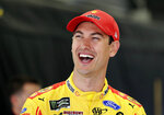 Joey Logano laughs as he waits before practice for Sunday's NASCAR Cup Series auto race at Charlotte Motor Speedway in Concord, N.C., Saturday, May 25, 2019. (AP Photo/Chuck Burton)