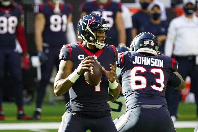 Houston Texans quarterback Deshaun Watson (4) looks to throw a pass against the Tennessee Titans during the first half of an NFL football game Sunday, Jan. 3, 2021, in Houston. (AP Photo/Sam Craft)