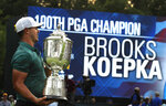 FILE - In this Aug. 12, 2018, file photo, Brooks Koepka holds the Wanamaker Trophy after winning the PGA Championship golf tournament at Bellerive Country Club in St. Louis. Koepka will try this week to become the first player to win three straight PGAs in stroke play. (AP Photo/Charlie Riedel, File)